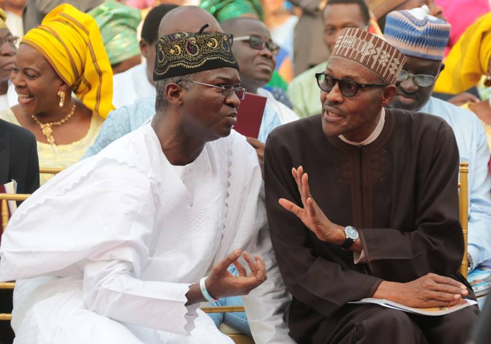 Lagos State Governor, Mr. Babatunde Fashola SAN (left) discussing with former Head of State and All Progressives Congress Presidential Candidate, General Muhammadu Buhari (right)