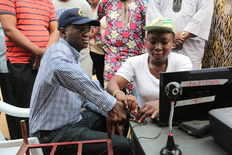 Lagos State Governor, Mr. Babatunde Fashola, SAN during re-registration for the Permanent Voters Cards (PVC)