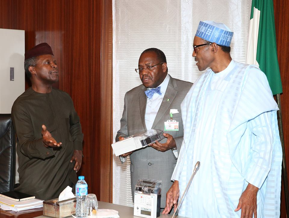 R-L; President Muhammadu Buhari, Permanent Secretary Ministry of Power, Ambassador Godknows Igali and Vice President Prof Yemi Osinbajo SAN, presents a locally made electricity meter during a briefing session by the Ministry of Power on it's activities at the State House Abuja.
